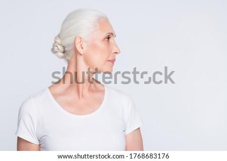 profile of senior woman over white background Stock photo © dolgachov