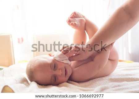 Momy cleaning baby skin with wet wipes Stock photo © adamr