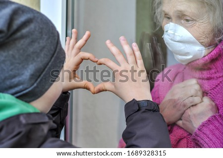 The hands of an elderly person and the hands of a child, the continuity of generations, the care of  Stock photo © galitskaya