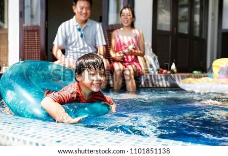 Children enjoying in summer resort at pool Stock photo © zurijeta