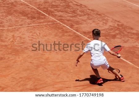 Fiú teniszező tanul győzelem játék fivér Stock fotó © Lopolo