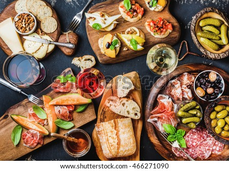 Cheese, meat, nuts and olives antipasto and wine Stock photo © karandaev