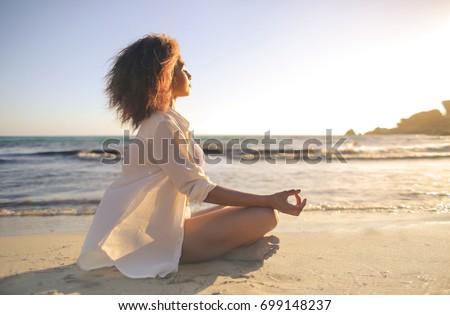 Woman doing yoga on beach Stock photo © dmitry_rukhlenko