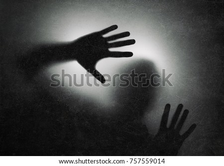 Stock photo: The shadow hands of human behind the glass