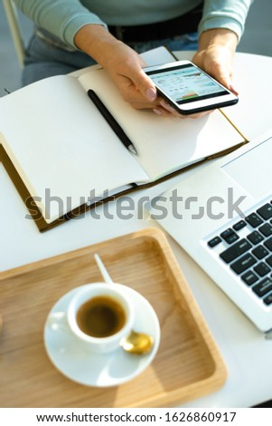 Hands of young female economist over open notebook analyzing financial data Stock photo © pressmaster