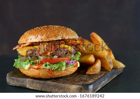 Burger cheeseburger tomates escuro comida carne Foto stock © furmanphoto