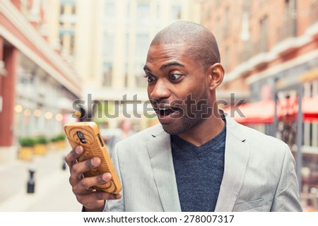 Businessman stunned by sms Stock photo © photography33