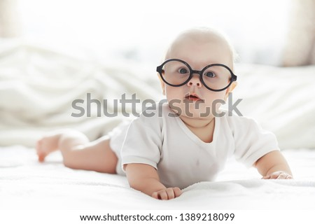 beautiful baby with glasses stock photo © zurijeta