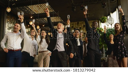 Group of businesspeople toasting glasses of champagne stock photo © wavebreak_media