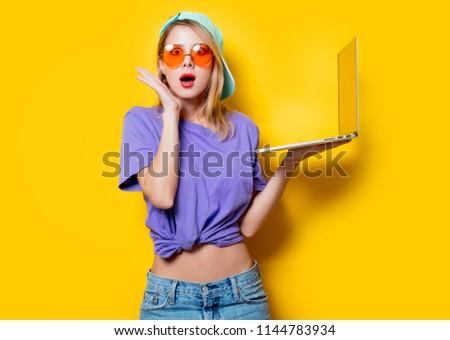 Girl in yellow shirt and hat Stock photo © colematt