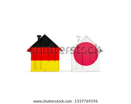 Two houses with flags of Germany and japan Stock photo © MikhailMishchenko