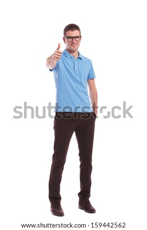 attractive man posing while holding his thumb in the pocket stock photo © feedough