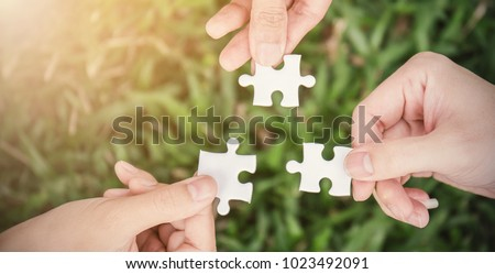 Group Of People Joining The White Puzzles On Grass Stock photo © AndreyPopov