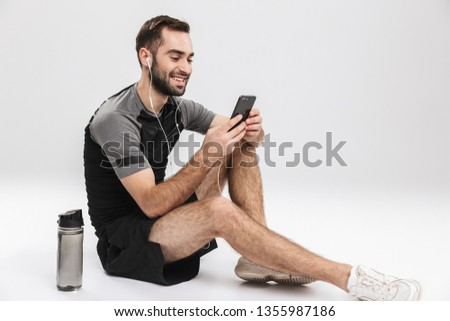 спортсмен изолированный мобильного телефона прослушивании музыку изображение Сток-фото © deandrobot