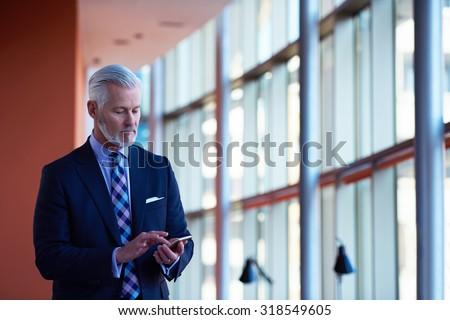 Старший деловой человек по мобильному телефону Сток-фото © dotshock