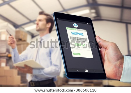 manager holding clipboard against boxes in warehouse stock photo © wavebreak_media