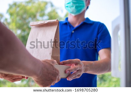 Deliverly man pick up food order Stock photo © vichie81