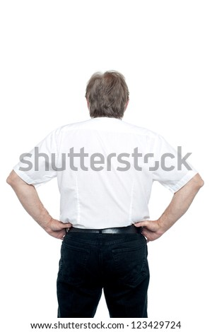 Senior manager poisng with hands on his waist Stock photo © stockyimages