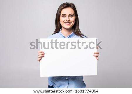 счастливым · бизнес-команды · указывая · Billboard · портрет - Сток-фото © aremafoto