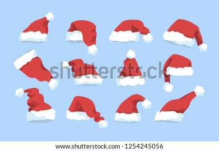 Set red Christmas hat with blue trim Stock photo © orensila