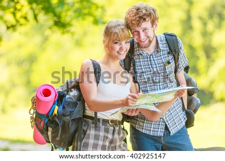Woman and man hiker with backpack reading map Stock photo © wavebreak_media