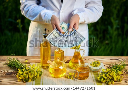 Agricultural concept, farmer, money and rapeseed field Stock photo © simazoran