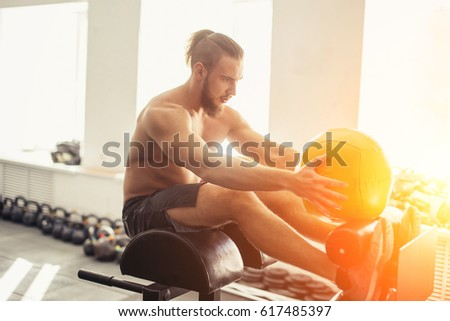 side view of a man doing crunches at beach stock photo © andreypopov