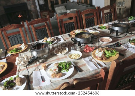 A Fondue Dinner  with Table and Equipement. Stock photo © Lopolo