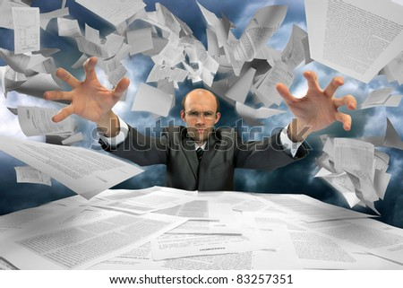 Serious businessman manipulating papers Stock photo © nomadsoul1
