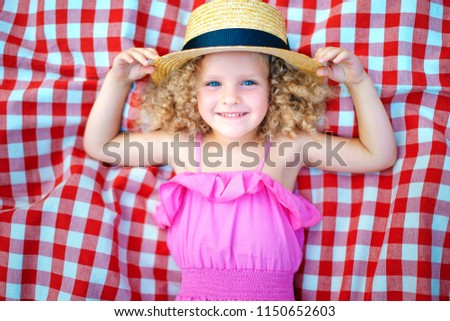 A girl with curly hair in the park Stock photo © ElenaBatkova