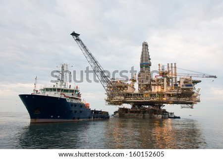 oil rig being tugged in the sea stock photo © elnur