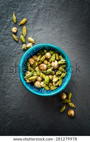 Various Cardamom Spices in Authentic Turkish Bowl Stock photo © dariazu