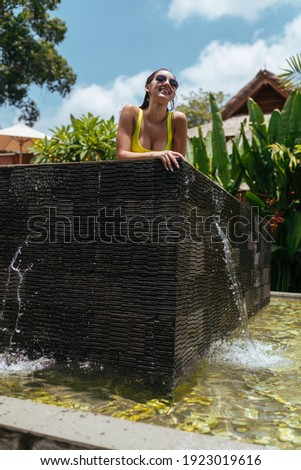 Cheerful smiling girl in swimsuit lying and looking at camera Stock photo © deandrobot