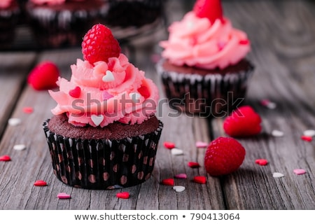 close up of cupcakes with red buttercream frosting Stock photo © dolgachov