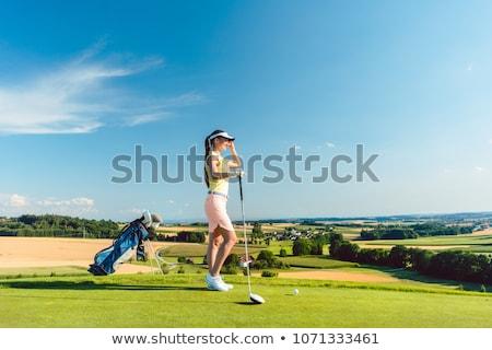 Femminile sacca da golf donna sorridente piedi tramonto Foto d'archivio © lichtmeister
