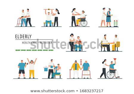 Front view of senior woman talking with disable senior man at nursing home Stock photo © wavebreak_media