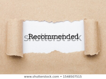 Recommended text appearing behind brown paper Stock photo © DenisMArt