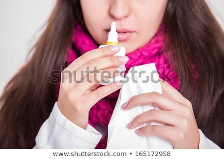sick woman using nasal spray at home Stock photo © dolgachov