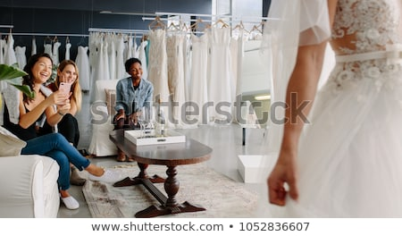 Bride Trying On Wedding Dress In Bridal Boutique Stock photo © HighwayStarz