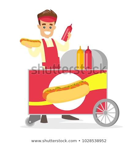 Hot dog venditore cibo di strada servizio uomo Foto d'archivio © robuart
