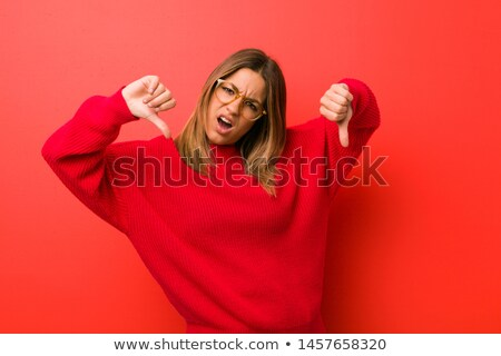 red student girl in glasses showing thumbs down Stock photo © dolgachov