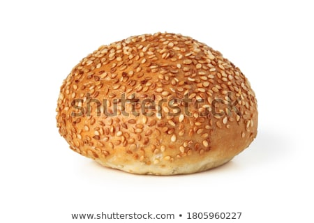 close up of hamburger bun crust with sesame seeds Stock photo © dolgachov
