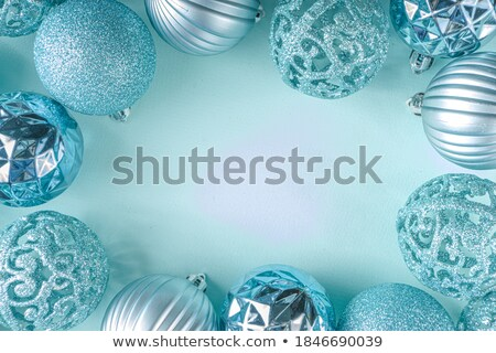 Christmas composition with blue ball and decoration over white Stock photo © Melnyk