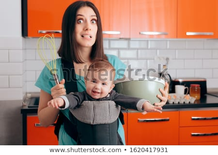 tired housewife preparing with egg beater Stock photo © vladacanon