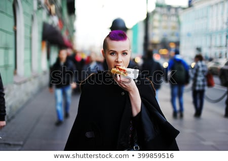 Teen girl bites grilled meat outdoors Stock photo © AndreyKr
