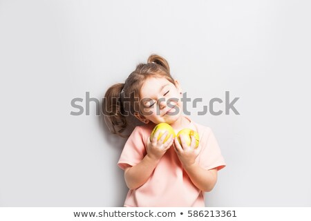 Cute little preschooler girl holding apple Stock photo © Lopolo