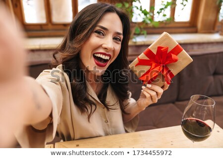 Photo of happy seductive woman laughing while sitting Stock photo © deandrobot