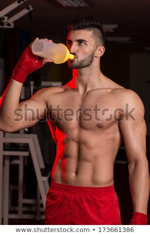 истребитель белок шейкер воды портрет мужчины Сток-фото © Jasminko