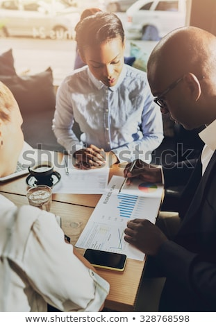 Entrepreneurs discussing the business plan for their startup Stock photo © Kzenon