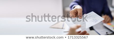 Hand Giving Payroll Compensation Paycheck Stock photo © AndreyPopov
